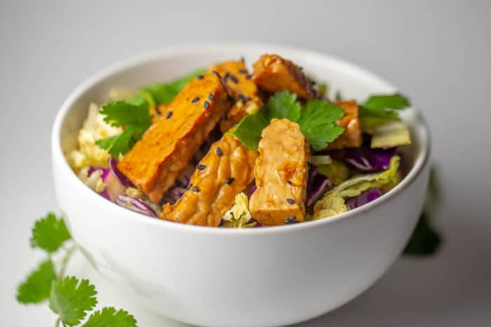 Raw vegan tempeh and cabbage salad with sesame dressing