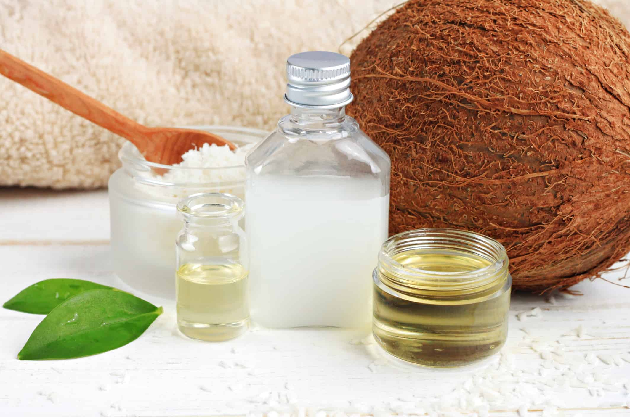 Skincare benefits. Bottles coconut oil, coconut milk, shavings.