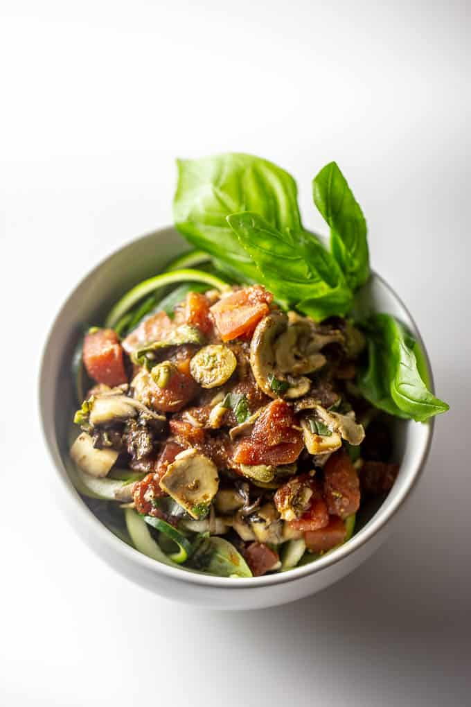 Cancer-fighting recipe for zoodles and spinach with raw puttanesca dressing is rich in antioxidants.